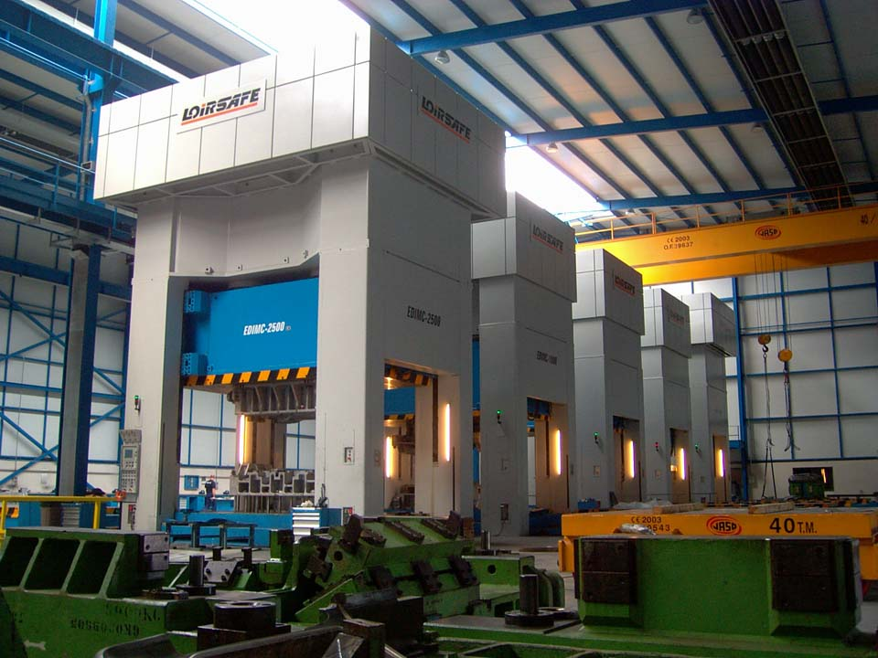 Line with five Hydraulic Presses (one 25.000 kN, three 10.000 kN and one 20.000 kN) with two side moving bolster per press.
